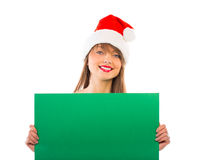Smiling christmas girl with green placard on white Stock Images