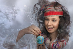 Smiling Christmas Girl and a hand with Christmas toy Stock Images