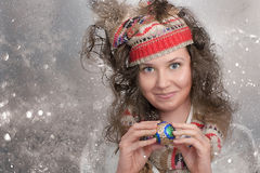 Smiling Christmas Girl and her hands with Christmas toy Royalty Free Stock Image