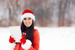Smiling Christmas Girl Holding Pc Tablet Royalty Free Stock Photos