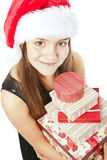 Smiling christmas girl holding presents over white Royalty Free Stock Photography