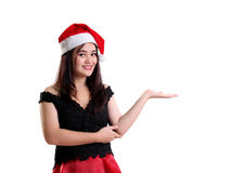 Smiling Christmas girl with presentation gesture royalty free stock photos