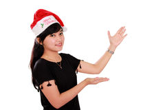Smiling Christmas girl presentation gestures Royalty Free Stock Images