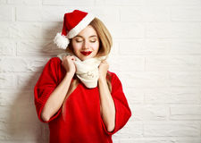 Smiling Christmas Girl in Red Winter Clothes Stock Photos