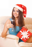 Smiling christmas girl with wineglass Stock Image