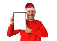 Smiling christmas man wearing a santa hat Royalty Free Stock Photos