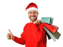 Smiling christmas man wearing a santa hat Stock Image