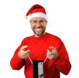 Smiling christmas man wearing a santa hat Stock Photography