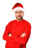 Smiling christmas man wearing a santa hat stock photo