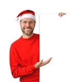 Smiling christmas man wearing a santa hat Stock Photography