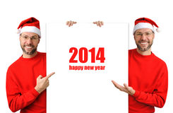 Smiling christmas man wearing a santa hat isolated on the white Royalty Free Stock Image
