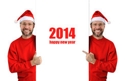 Smiling christmas man wearing a santa hat isolated on the white Royalty Free Stock Images