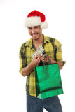 Smiling Christmas shopper Royalty Free Stock Photo