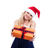 Smiling Christmas woman giving present Royalty Free Stock Images