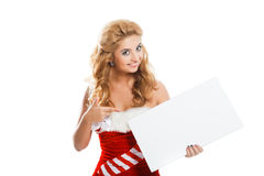 Smiling christmas woman holding blank poster. Royalty Free Stock Images