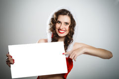 Smiling christmas woman holding blank poster Royalty Free Stock Photo