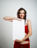 Smiling christmas woman holding blank poster Royalty Free Stock Image