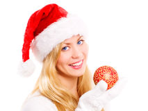 Smiling christmas woman holding glass ball Royalty Free Stock Photos