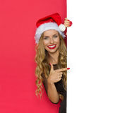 Smiling Christmas Woman Pointing At Placard Stock Image