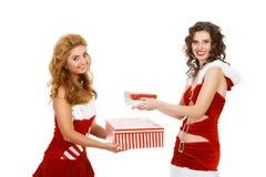 Smiling christmas women holding gift. Stock Photo