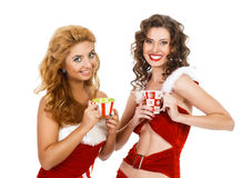 Smiling christmas women with tea pair wearing santa clothes Stock Photography