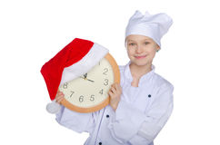 Smiling Christmas young chef  with dial. Smiling Christmas young chef with dial isolated on white Royalty Free Stock Photos