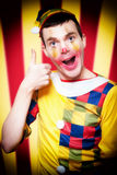 Smiling Circus Clown Standing Inside Bigtop Tent. Playful Smiling Circus Clown Standing Inside Bigtop Tent Giving Thumbs Up For Good Entertainment While Stock Photos