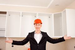 Smiling civil engineer shows new apartment Stock Photos