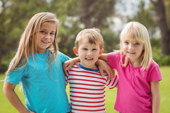 Smiling classmates with arms around each other Stock Photography