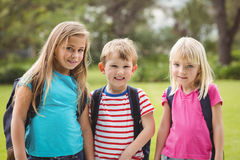 Smiling classmates with schoolbags Stock Images