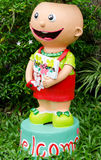 Smiling clay doll holding welcome signboard Stock Photography