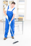 Smiling cleaner at the office Royalty Free Stock Photos