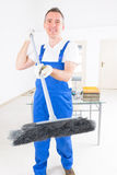 Smiling cleaner at the office Royalty Free Stock Photography