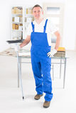 Smiling cleaner at the office Stock Images