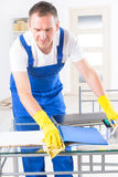 Smiling cleaner at the office Stock Photo