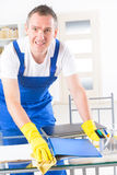 Smiling cleaner at the office Stock Image