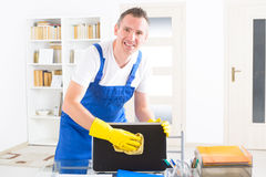 Smiling cleaner at the office Royalty Free Stock Images