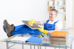 Smiling cleaner at the office Royalty Free Stock Photo