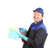 Smiling cleaner with sponges. Royalty Free Stock Photography