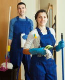 Smiling cleaners team at door Stock Image