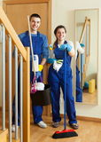 Smiling cleaners team is ready Royalty Free Stock Image