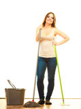 Smiling cleaning woman mopping floor. Cleanup housework concept. Smiling cleaning girl young woman mopping floor, holding two mops new and old white background Stock Photography