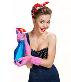 Smiling cleaning woman wearing pink rubber protective gloves holding blue spray Royalty Free Stock Photo
