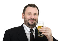 Smiling clerk with glass of lager. Smiling bearded clerk rises a glass of lager on a white background Royalty Free Stock Images