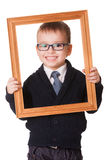 Smiling clever boy in wooden frame Stock Images