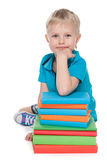 Smiling clever little boy with books Stock Photos