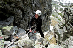 Smiling climber on alpinist route Royalty Free Stock Photography