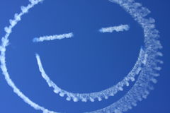 Smiling Clouds in the sky. Clouds created by airplane with preparation to airshow Stock Photos