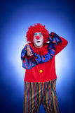 Smiling clown on blue background Stock Images