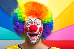 Smiling clown on a colorful background Stock Photo